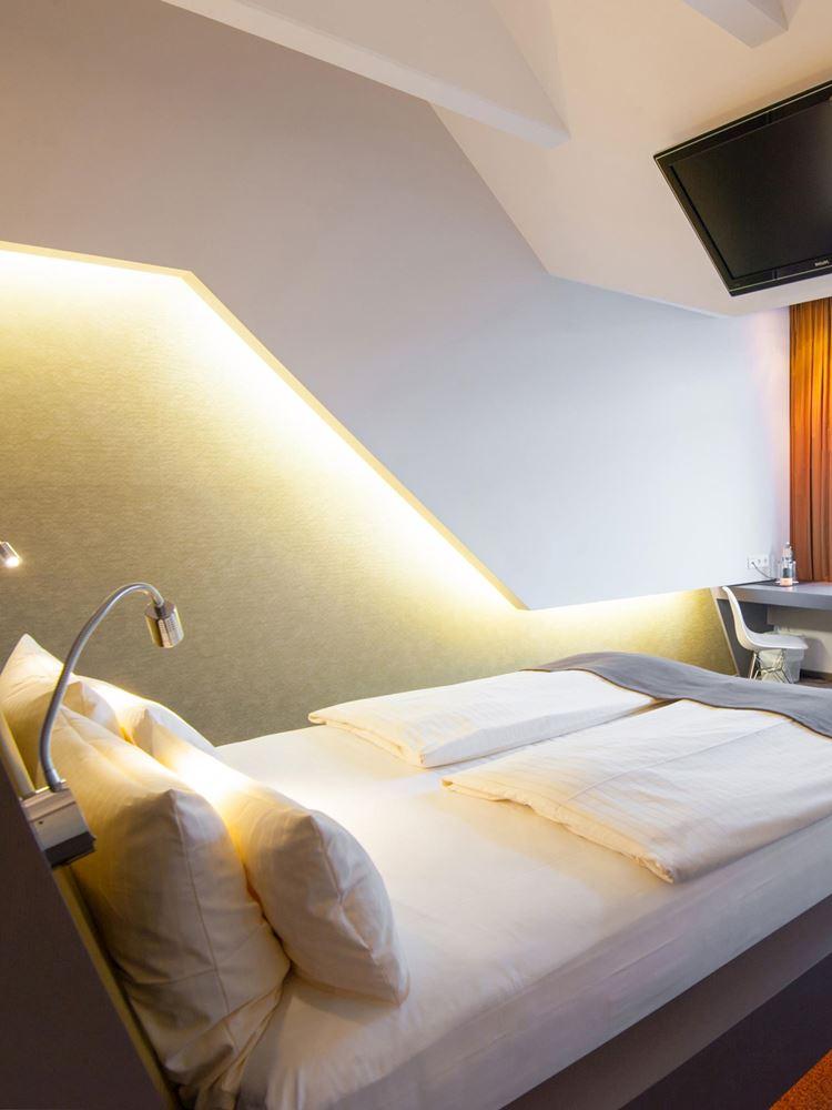 Chambre de 30 m², Draps et couettes de luxe a l'Aspria